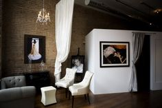 Love this changing room, curtain divider, and chandelier!