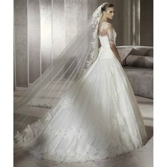 Google Image Result for http://3.bp.blogspot.com/-1A3sU01D8bM/TlebFpJyKfI/AAAAAAAAAdI/VvK6sHlaoaA/s640/tulle-softly-curved-neckline-lace-appliqued-illusion-overlay-with-sabrina-neckline-and-sleeves-with-beaded-waistline-with-bow-back-and-draped-skirt-with-lace-applique-accents-chapel-train-2012-new-arrival-ball-gown-wedding-dress.jpg