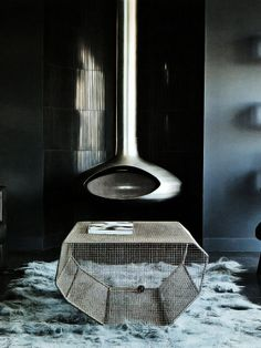 dark charcoal floors, lighter shade of charcoal on painted wall and glossy black spray paint on the column.