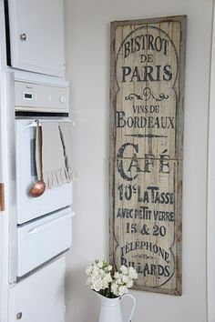 love all these old and unique signs for a kitchen.  The question is where to get them. Homescence often sells reproductions but I'd love the real thing.  Flea markets  may be a place to start