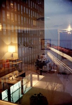 "The caption that originally accompanied this image when it ran in LIFE: ""Reflections mirrored in glass wall of an apartment building on Lake Shore Drive building merge like a mirage with outside view of companion building and the lights of traffic."""