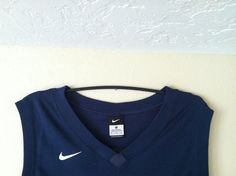 Hang a sports jersey with an upside down hanger instead of paying $$$ for a hanging rod!!