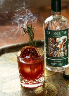 An extraordinary ode to the most dramatic of winter fruits, this Blood Orange Negroni is best crowned with fresh rosemary. Blood Orange Cocktail, Blood Orange Margarita, Blood Orange Juice, Sipsmith Gin, Rosemary Cocktail, Vodka Lime, Lime Juice, Orange Buttercream, London Dry Gin