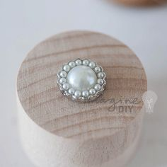 Beautiful small embellishment with pearl cluster details Perfect to add an elegant finishing touch. Measurements: Appx 1.5cm Flat backed