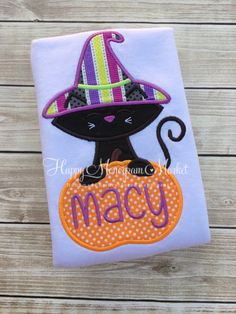 Halloween Fall Kitty Cat Witch Hat and Pumpkin Personalized Monogrammed Shirt Tshirt bodysuit Fall Festival Trick or Treat Outfit Personalize your very own Witch Cat in a Pumpkin for the fall season.  Please comment: -name to be added to design  Items are handmade with the highest quality products and attention to detail. A mesh covering is used on the backside to provide comfit to your little ones skin.  Thank you for choosing Happy Monogram Market!  Facebook Page…