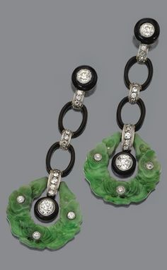 Pair of jade, onyx and diamond earrings, circa 1925. The long fringes composed…