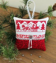 Love the vintage-look design, the simple red and white, and wonderful finishing touches. Stitching Dreams blog.