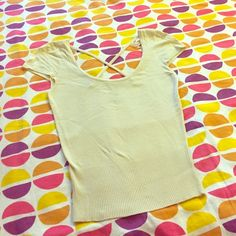 Pale yellow/cream cap sleeve banded-bottom top Criss cross back, very stretchy, pairs well with the brown skirt in my closet! Has hanging loops intact Rampage Tops Tees - Short Sleeve