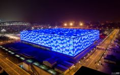 The National Aquatics Center, also known as the 'Water Cube', was one of the most dramatic and exciting sporting venues constructed for the 2008 Beijing Olympic Games. Enclosed within the bubble walls are five swimming pools (including a wave machine and rides), a restaurant and seating and facilities for 17,000 spectators. The building's distinctive appearance inspired by soap bubbles.