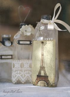 Midnight in Paris Wedding Centerpiece: Decorate antique glass bottles with lace, craft paper, ribbon, paper flowers, and some bling and then fill with single over sized bloom like peonies or dahlias.