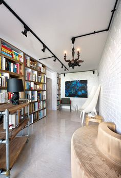 Brick wall, black lights, flooring - A new whitewashed brick wall, quirky designer seats and a painting by Mike set the tone for the stylish reading room.