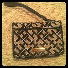 """Tommy Hilfiger Wristlet Wallet Standard wallet with """"TH"""" print. Leather accents. 13.5 cm by 9.5 cm when closed. Not new, but in excellent condition. Tommy Hilfiger Bags Wallets"""