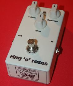 The ring 'o' roses rat guitar pedal by Butterfly Effect Pedals, in matt white finish with matching white knobs.