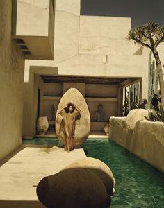 An inverted Spanish olive pot next to the pool. Photographer Philip Dixon home in Venice Beach, CA