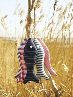 Sew fabric fish for simple craft/hand eye coordination with button eyes