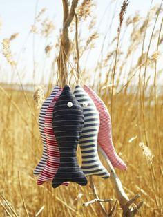 Sew fabric fish decorations