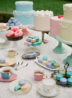 Macarons + tiny cakes...all in pretty pastels! We can even order glittery, go,d-dusted macaroons.