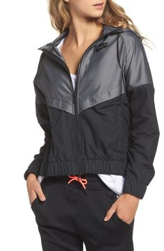 Slip into a cool retro look with this color-blocked bomber jacket finished with a dropped hem for extra coverage.
