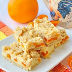 Apricot Orange Cheesecake Bars - apricot and orange is a great flavor combination and go deliciously hand in hand in these buttery cheesecake squares.
