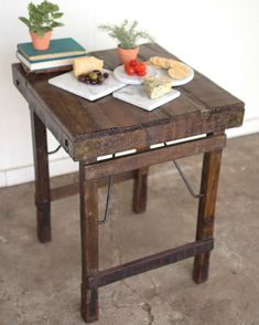 Our stunning Rustic Wooden Plank Table with Folding Legs is made of reclaimed wood, and provides the perfect addition to compliment your kitchen, dining room, or wherever you might need additional surface space. The unique design of the table allows you to fold the legs in so that the table can be stored when not in use. We love its rich dark wood which offers an old-world style similar to what you may find at a market place in India. It is large enough to be used as a small kitchen island or a Small Kitchen Tables, Modern Kitchen Island, Wooden Kitchen, Small Tables, Small Kitchen Islands, Kitchen Dining, Rustic Furniture, Home Furniture, Furniture Movers