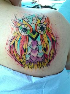Watercolor owl tattoo by Mike Hughes Hallowed Point Tattoo in Palm Bay Fl.  HallowedPointTattoo.com
