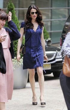 Rachel Weisz  in a blue tie-belt tunic dress and chain strap purse