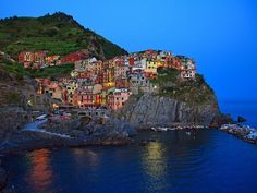 Manarola (Manaea in the local dialect) is a small town, a frazione of the comune (municipality) of Riomaggiore, in the province of La Spezia, Liguria, northern Italy. It is the second smallest of the famous Cinque Terre towns frequented by tourists.Manarola may be the oldest of the towns in the Cinque Terre, with the cornerstone of the church, San Lorenzo, dating from 1338.