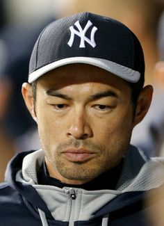 Ichiro Suzuki #31 of the New York Yankees looks on from the dugout in the third inning against the New York Mets during interleague play on ...