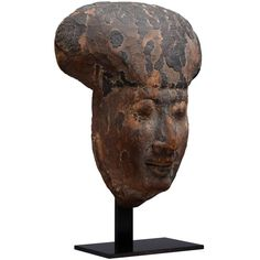 Ancient Egyptian Wooden Sarcophagus Face Mask, 200 BC | From a unique collection of antique and modern sculptures at https://www.1stdibs.com/furniture/decorative-objects/sculptures/