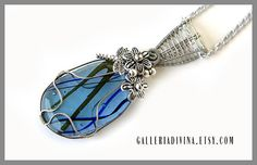 Blue glass flower pendant - Wire wrapped - fused glass - metal flowers