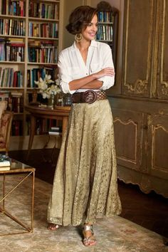 Silk Sienna Skirt  Sweep into view in a dazzling skirt of shimmery golden matte satin in a chic, subtly textured, stylized animal print, fashioned of panels and godets that cr