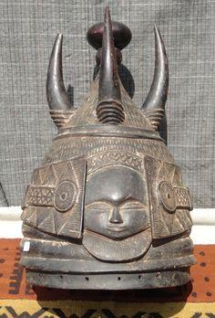 African tribal art   West African hand carved helmet mask - Bundu/Sande society - women's secret society; sowei, ndoli jowei - Mende tribe, Sierra Leone