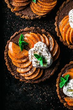These easy vegan chocolate tarts are made with a gluten free oat and almond base and topped with sweet, summery apricots for a beautiful & simple dessert. The easy press-in base and quick ganache filling makes for a low stress treat. #vegan #summer #chocolate #dairyfree #eggfree #tarts