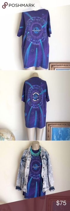 """VTG 90's Purple Harley Davidson T-shirt Tee Shirt WILD vintage 1990's. 1995 back left. Purple w/ lilac, white, teal, blue, green, & turquoise print. """"OUT OF THIS WORLD"""" front & back w/ Harley Davidson center of Earth, shooting stars, & logo & engine constellations.   Size Large, PERFECT oversized shirt dress! May be too short alone, layer over biker shorts!   Consistent fading around, otherwise AMAZING condition!! """"Mathews Fresno, CA"""" white print on back is cracked. [75]  Length: 29 in…"""
