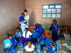 A volunteer teaching small children in a local school, in Ghana