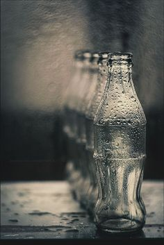 the black and white bottles demonstrate repetition. i like how the bottle are wet it really adds to the image.