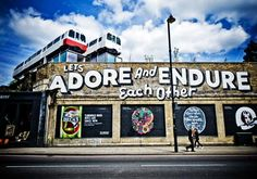 Let's adore and endure each other. Some big and very awesome #streetart in #shoreditch    via @jamesrdesigner