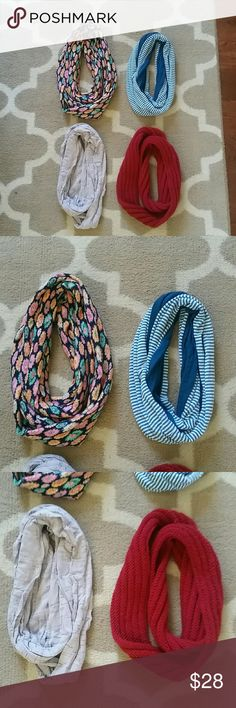 Lot of 4 beautiful infinity scarves These beautiful scarves have been very gently worn and well-cared-for from a smoke-free home. All are soft and machine washable. The floral one is  knit, the striped and grey are a lighter Jersey, and the red is  hand-knit from New yarn. Accessories Scarves & Wraps