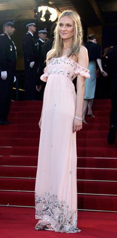 Over 30 Snaps of Diane Kruger's Impeccably Cool Cannes Film Fest Style — See It Here: She looked ravishing in a white ultraruffled gown by Chanel Haute Couture at the 2006 Palme d'Or Awards closing ceremony.  : Diane went for bohemian goddess in this light pink off-the-shoulder Roberto Cavalli number in 2005.