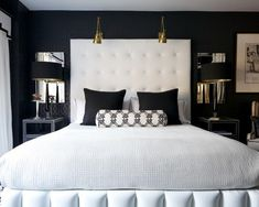 Tall Headboard, sconces, bedside mirrors and lamps.
