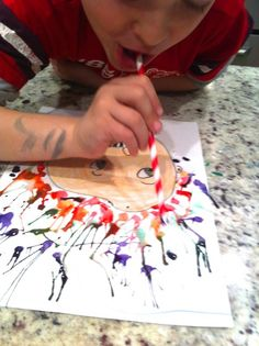 blow painting. Make an awesome crazy hair portrait with crayons, watercolors and a straw!