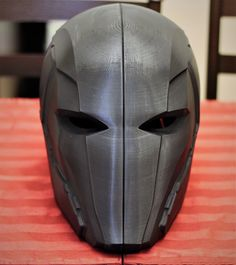 This a raw 3D print of the Red Hood Injustice 2 helmet. The helmet is printed in two parts. These helmets are printed in PLA and have some ruffs spots just from the 3D printing process itself. Typical finishing work will be needed to be done to get them smooth. The helmet does not come with padding. Please measure your head before purchasing. We do not accept refund of this helmet. Robot Concept Art, Armor Concept, Helmet Design, Mask Design, Red Hood Helmet, Futuristic Helmet, Tactical Helmet, Sci Fi Armor, Cosplay Armor