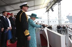 Queen Elizabeth christens the Scottish warship with whiskey.
