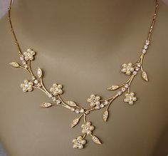 Flower Necklace    Price: $46.95 at amazon.com  This necklace has lovely flowers and tiny crystal leaves branching off of a silver chain all the way down with …