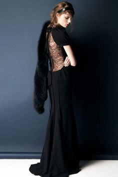 velvet.. i don't know what the hanging thing is, but the dress is GORGEOUS!!