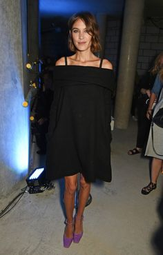 Alexa Chung wears an off-the-shoulder black mini dress with purple ankle-strap square toe heels