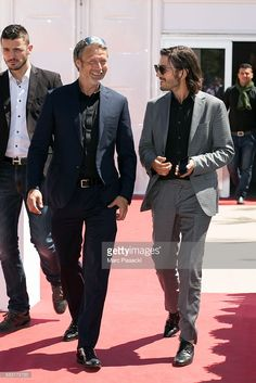 Actors Mads Mikkelsen and Diego Luna leave the 'Agora' during the annual 69th Cannes Film Festival on May 21, 2016 in Cannes, France.