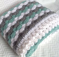 "Crochet Baby Blanket Baby Boy Blanket Baby by HookYarnAndHooper $84.99 Beautiful sage green, white and gray striped baby blanket perfect for anyone looking for a nice, gender neutral gift or heirloom. This crocheted baby blanket measures 30""x37"" which makes it large enough to snuggle a newborn and keep through toddler years. Handmade in a smoke-free home. #craftshout0415"