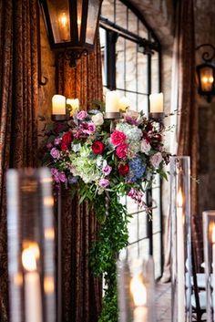 Candelabra Decorated with Organic Flowers    Photography: Jared Platt Photography   Read More:  http://www.insideweddings.com/weddings/classic-arizona-wedding-of-denver-broncos-nfl-player-brock-osweiler/701/