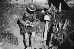 highlander reading a letter.    kilt!